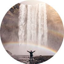 Man celebrating waterfall rainbow- Jared Erondu unsplash photo 210circ